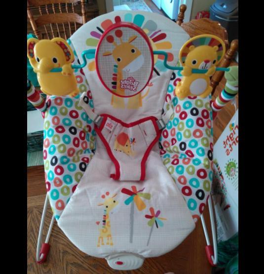 Playful pinwheels bouncer vibrating seat baby