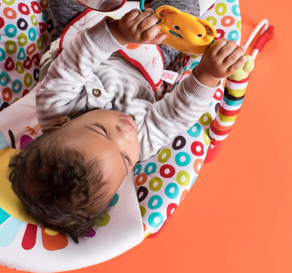 Playful pinwheels bouncer with vibrating seat for baby