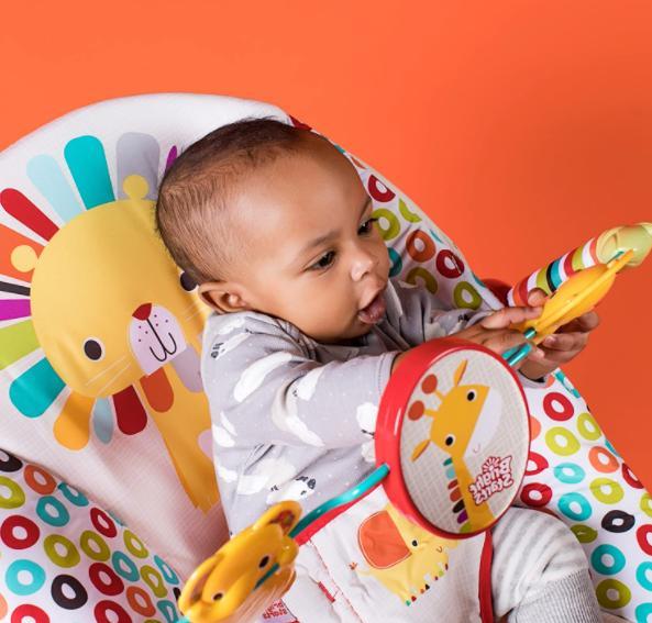 Playful pinwheels bouncer vibrating seat